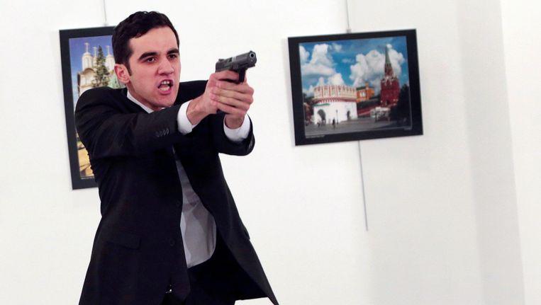 Een fotograaf van het persagentschap AP kon de schutter op beeld vastleggen. Beeld AP