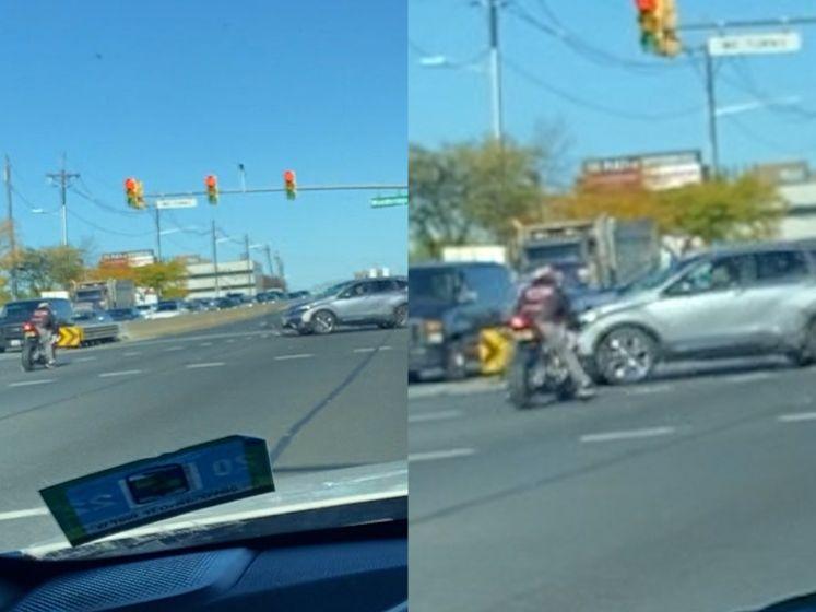 Motard rijdt door rood en wordt bijna geschept door auto