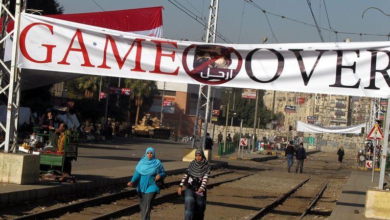 Een spandoek tegen de Egyptische president Morsi Beeld ANP