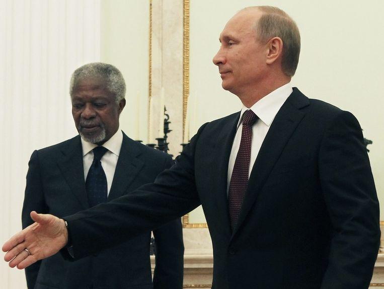 De Russische president Vladmir Poetin en VN-gezant Kofi Annan. Beeld epa