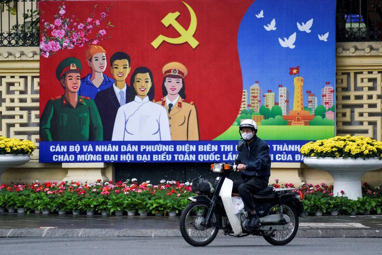 Een poster van het congres in hoofdstad Hanoi. Beeld REUTERS