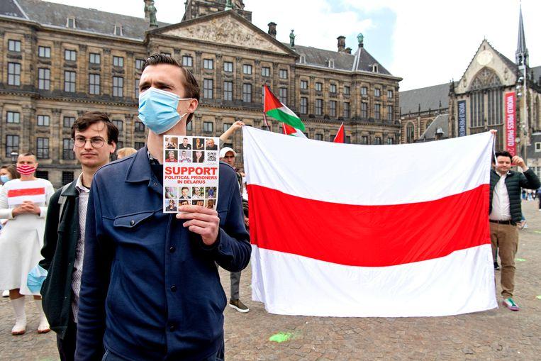 De actievoerders protesteren tegen het beleid van president Aleksandr Loekasjenko van Belarus. Beeld Hollandse Hoogte /  ANP