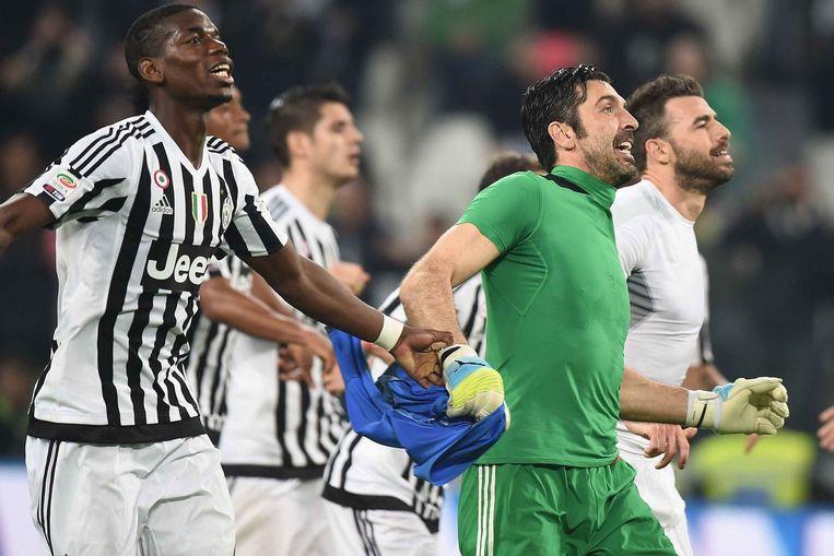 Spelers van Juventus vieren feest. Beeld photo_news