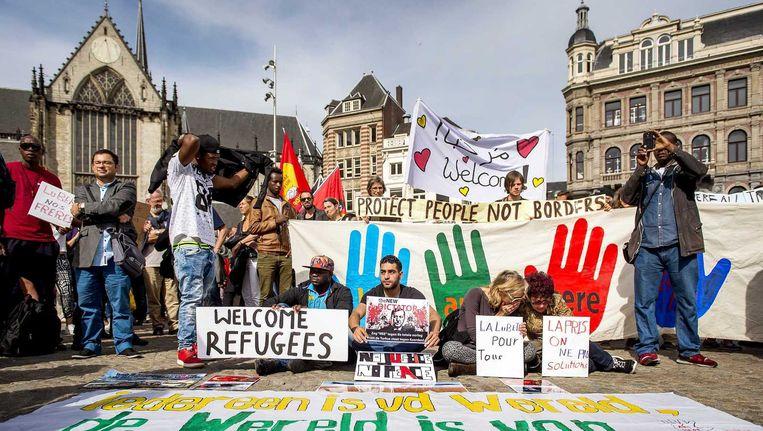 De landelijke demonstratie Vluchtelingen Welkom op de Dam, zondag. Beeld ANP