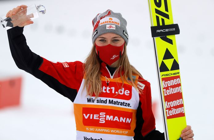 epa08977510 Marita Kramer of Austria celebrates on the podium after winning the Women's Single competition at the FIS Ski Jumping World Cup in Titisee-Neustadt, Germany, 31 January 2021.  EPA/RONALD WITTEK