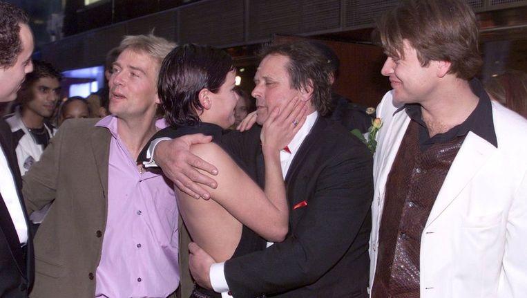 Ruud van Hemert (midden) bij de première van Ik ook van jou. Beeld Brunopress