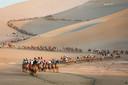 Toeristen in Dunhuang in het noordwesten van China.