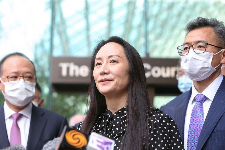 Huawei-topvrouw Meng Wanzhou spreekt de media toe na haar vrijlating, in Vancouver, Canada. Beeld REUTERS