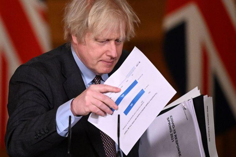 Er wordt in ons land met enige jaloezie gekeken naar het Verenigd Koninkrijk, waar premier Boris Johnson deze week een gedetailleerde kalender uit de doeken deed. Beeld AFP
