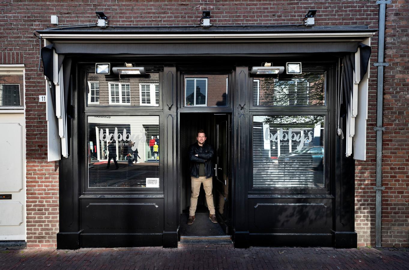 Geert Blenckers voor een van zijn zaken in Helmond.