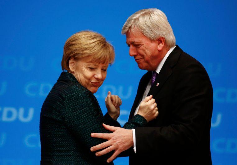 Merkel en vicevoorzitter van haar partij CDU Volker Bouffier. Beeld REUTERS