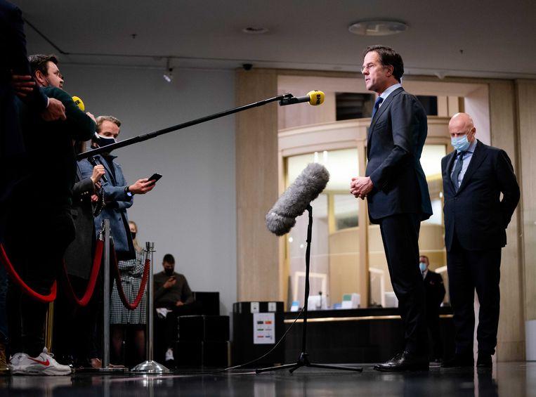Premier Mark Rutte en minister Ferd Grapperhaus staan de pers te woord. Beeld EPA