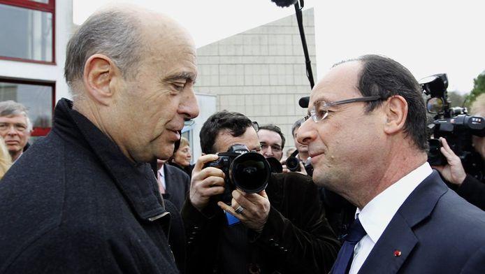 L'ex-Premier ministre et ministre des Affaires étrangères Alain Juppé (UMP) et François Hollande