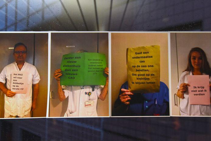 Honderden foto's van protesterende medewerkers van het Amphia ziekenhuis zijn opgehangen in de toegangshal van de vestigingen aan de Molengracht en Langendijk in Breda.  Volgens het actiecomite in het ziekenhuis dat voor volgende week dinsdag een zondagsdienst heeft uitgeschreven als protest tegen de vastgelopen cao-onderhandelingen is dat het gevolg van de angstcultuur die in het ziekenhuis zou heersen.