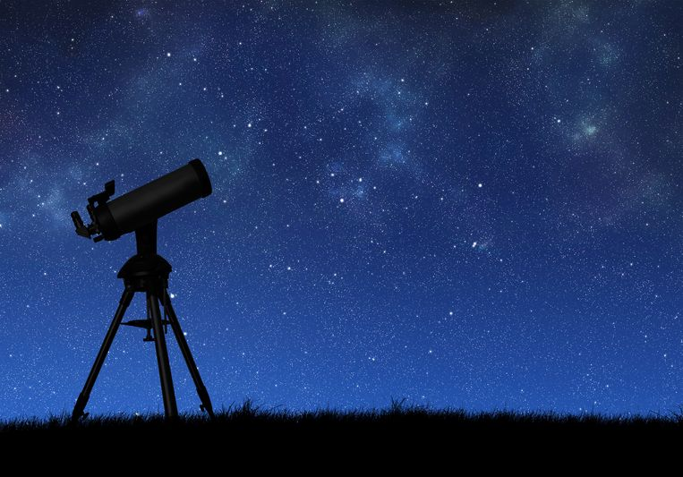 Telescope silhouette against the starry sky