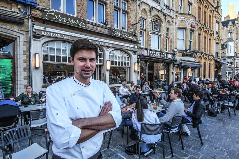 Laurent Walraedt van De Kollebloeme op de Grote Markt in Ieper is tevreden met het vervroegde terrasseizoen.