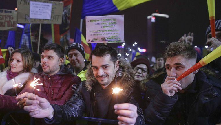 Demonstranten in Boekarest. Beeld reuters