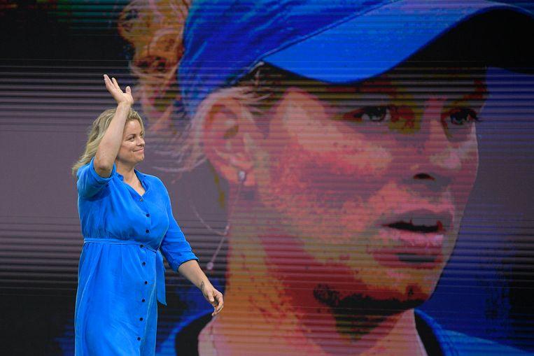 Kim Clijsters groet de fans in New York. Ze komt in de kampioenengalerij van de US Open. Beeld BELGA