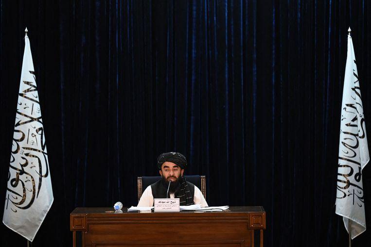 Taliban-woordvoerder Zabihullah Mujahid maakte de benoemingen dinsdag tijdens een persconferentie bekend Beeld AFP
