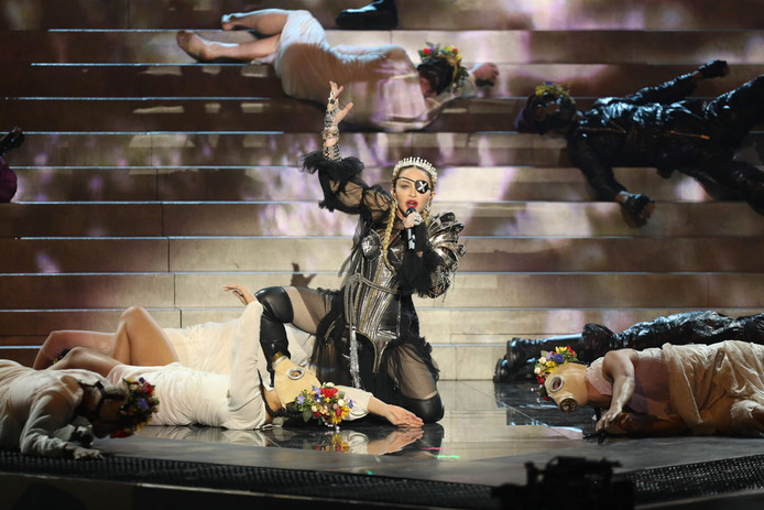 """TOPSHOT - This handout photo released by KAN shows Madonna performing during a guest appearance at the 64th edition of the Eurovision Song Contest 2019 at Expo Tel Aviv on May 19, 2019, in the Israeli coastal city of Tel Aviv. (Photo by Orit Pnini / KAN / AFP) / RESTRICTED TO EDITORIAL USE - MANDATORY CREDIT """"AFP PHOTO / KAN / ORIT PNINI  """" - NO MARKETING NO ADVERTISING CAMPAIGNS - DISTRIBUTED AS A SERVICE TO CLIENTS"""