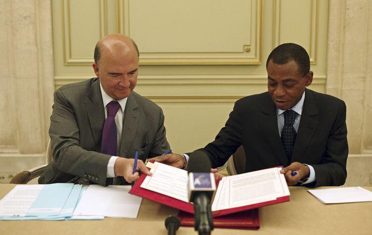 Moscovici en Charles Koffi Diby. Beeld AP