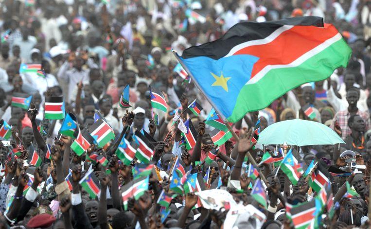 Duizenden inwoners van de nieuwe staat Zuid-Soedan vierden tien jaar geleden in de hoofdstad Juba de onafhankelijkheid van hun land van Soedan.  Beeld AFP