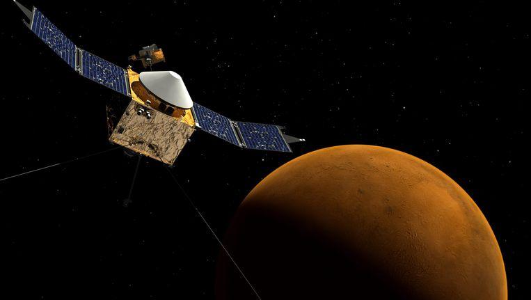 Ruimtesonde Maven, met op de achtergrond Mars. Beeld EPA