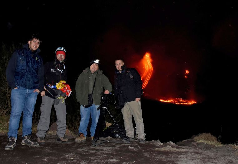 epa07248297 A group of hikers with camera equipment poses in front of lava flowing downhill after an eruption of the the Etna volcano, near Catania, Sicily island, southern Italy, 24 December 2018 (issued 25 December 2018). The intense seismic activities of Mount Etna continue with - among dozens of earthquakes that were detected at 08:26 pm on 24 December - the National Institute of Geophysics and Volcanology (INGV) having registered a magnitude-4 strong quake with its hypocenter at a depth of only two kilometers and the epicenter some seven kilometers northeast of Ragalna, in the province of Catania.  EPA/ORIETTA SCARDINO Beeld EPA