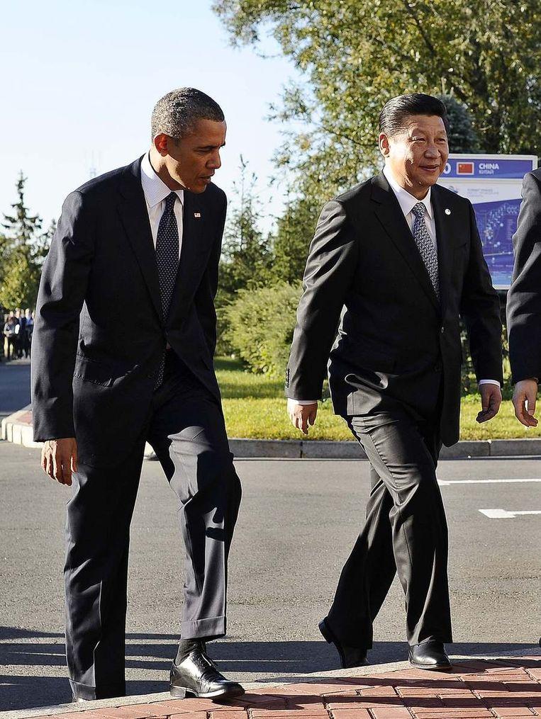 Obama met de Chinese president Xi Jinping. Beeld afp