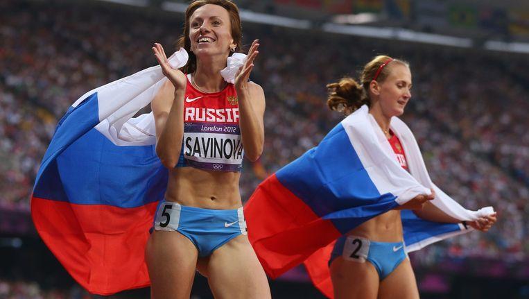 Mariya Savinova en Ekaterina Poistogova in Londen 2012: medaillewinst met een geurtje aan. Beeld © getty