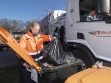 Pizzadoos en etensresten in verkeerde afvalbak in Hof van Twente? Oranje kaart!