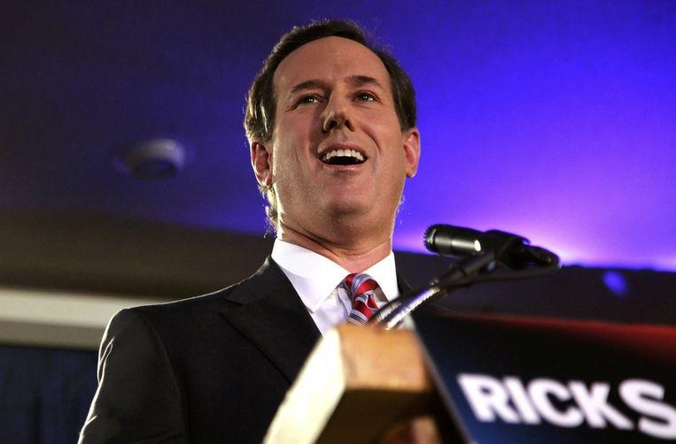 Een glunderende Rick Santorum. Beeld REUTERS