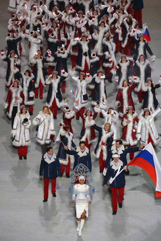 Russische sporters tijdens de openingsceremonie van de winterspelen in Sochi. Beeld AFP