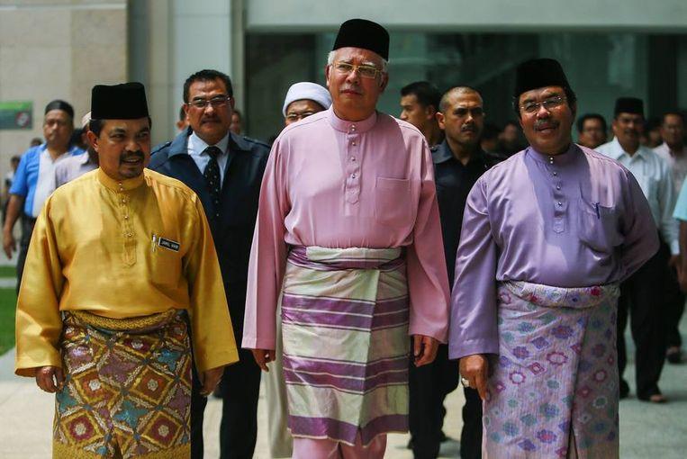 De Maleisische premier Najib Razak (midden). Beeld REUTERS
