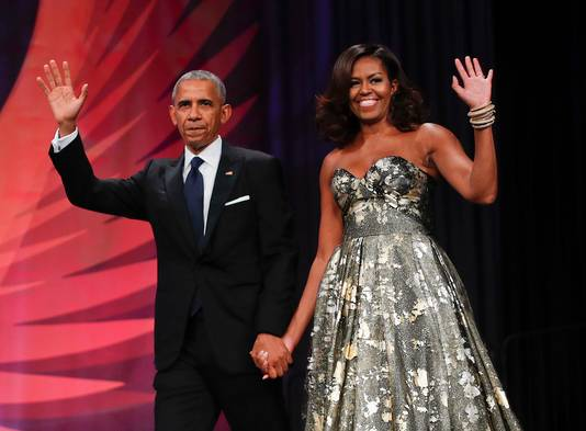 Barack en Michelle hebben hun nette kleding verruild voor een korte broek.