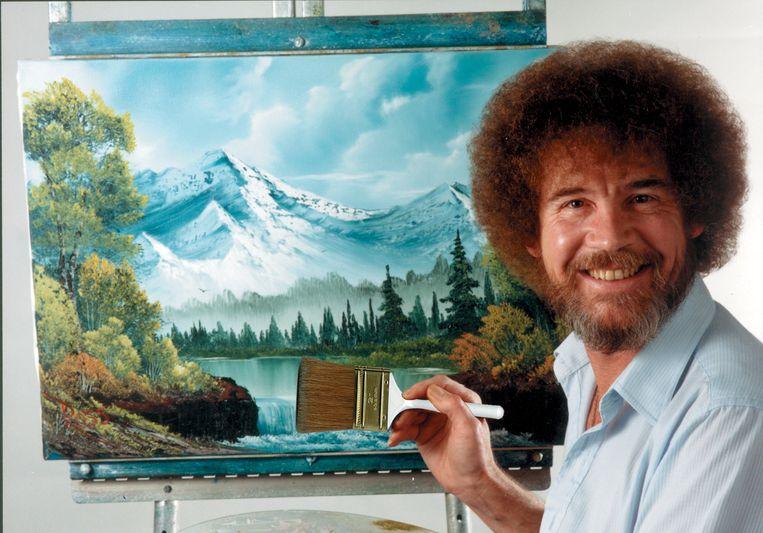 Bob Ross met een van zijn vele schilderijen. Beeld Bob Ross Inc.