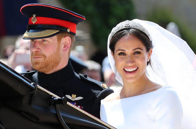 Prince Harry en Meghan Markle op hun huwelijksdag. Beeld AFP