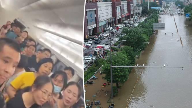 """Zwaarste regenval in 100 jaar in Chinese metropool: minstens 25 doden, """"pendelaars zitten al 44 uur vast"""""""