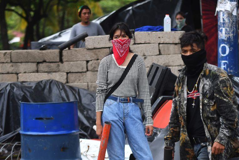 Studentenbetogers met zelfgemaakte mortieren in Managua. Beeld AFP