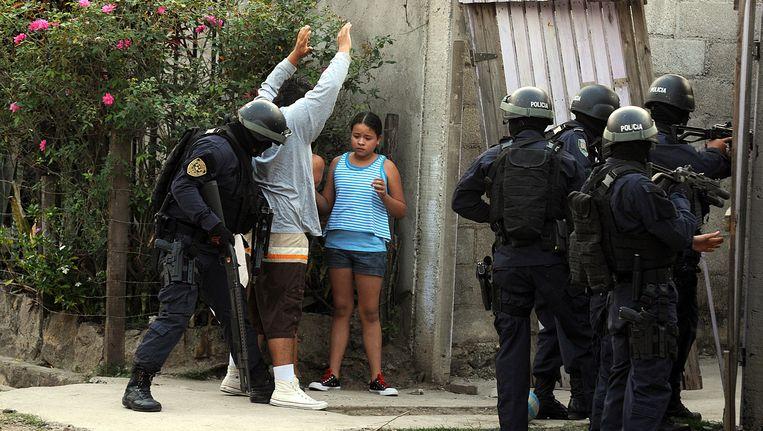 De politie in Honduras heeft de handen vol met bendegerelateerd geweld. Beeld AP