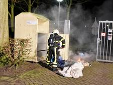 Kledingcontainer in brand in Hilvarenbeek