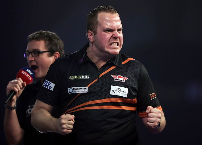 Dirk van Duijvenbode celebrates after winning a set against Rob Cross during day eight of the World Darts Championship at Alexandra Palace in London, Tuesday, Dec. 22, 2020. (Kieran Cleeves/PA via AP)