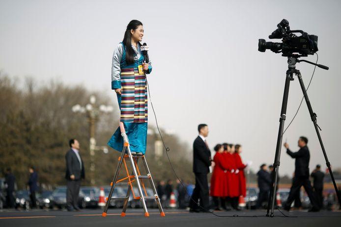 Een journalist in Beijing, China.