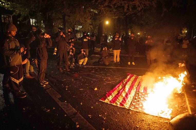 Een demonstratie op verkiezingsdag in Portland, Oregon. Beeld EPA