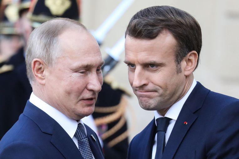 Russisch president Vladimir Poetin en zijn Franse collega Emmanuel Macron in december 2019.  Beeld AFP