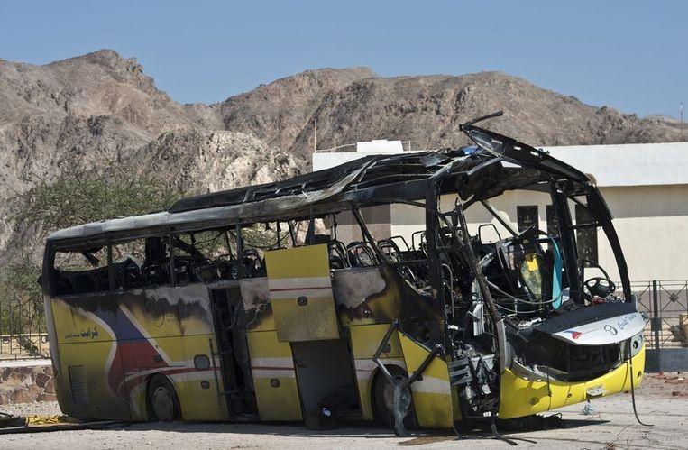 De uitgebrande toeristenbus na de aanslag. Beeld AFP