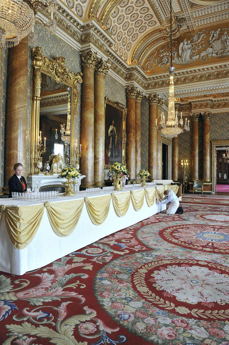 De blauwe salon in Buckingham Palace. Beeld AFP