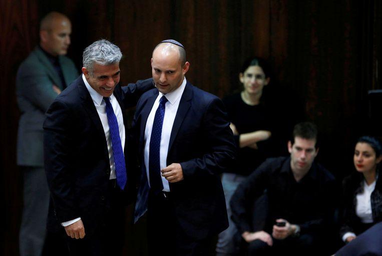 Archiefbeeld van Yair Lapid (links) en Naftali Bennett. Beeld REUTERS