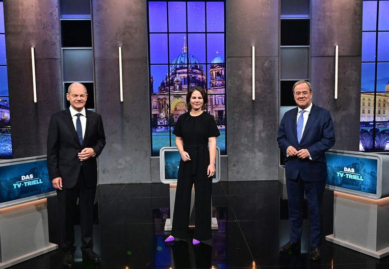 Olaf Scholz (SPD), Annalena Baerbock (De Groenen) en Armin Laschet (CDU/CSU) tijdens een televisiedebat. Op 26 september kiest Duitsland wie Angela Merkel opvolgt. Beeld AFP