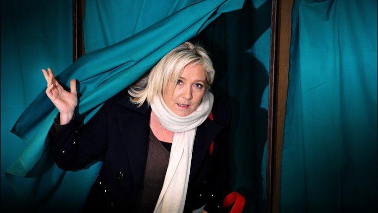 Marine Le Pen, nadat ze haar stem uitbracht tijdens de regionale verkiezingen in Frankrijk. Beeld PHOTO_NEWS